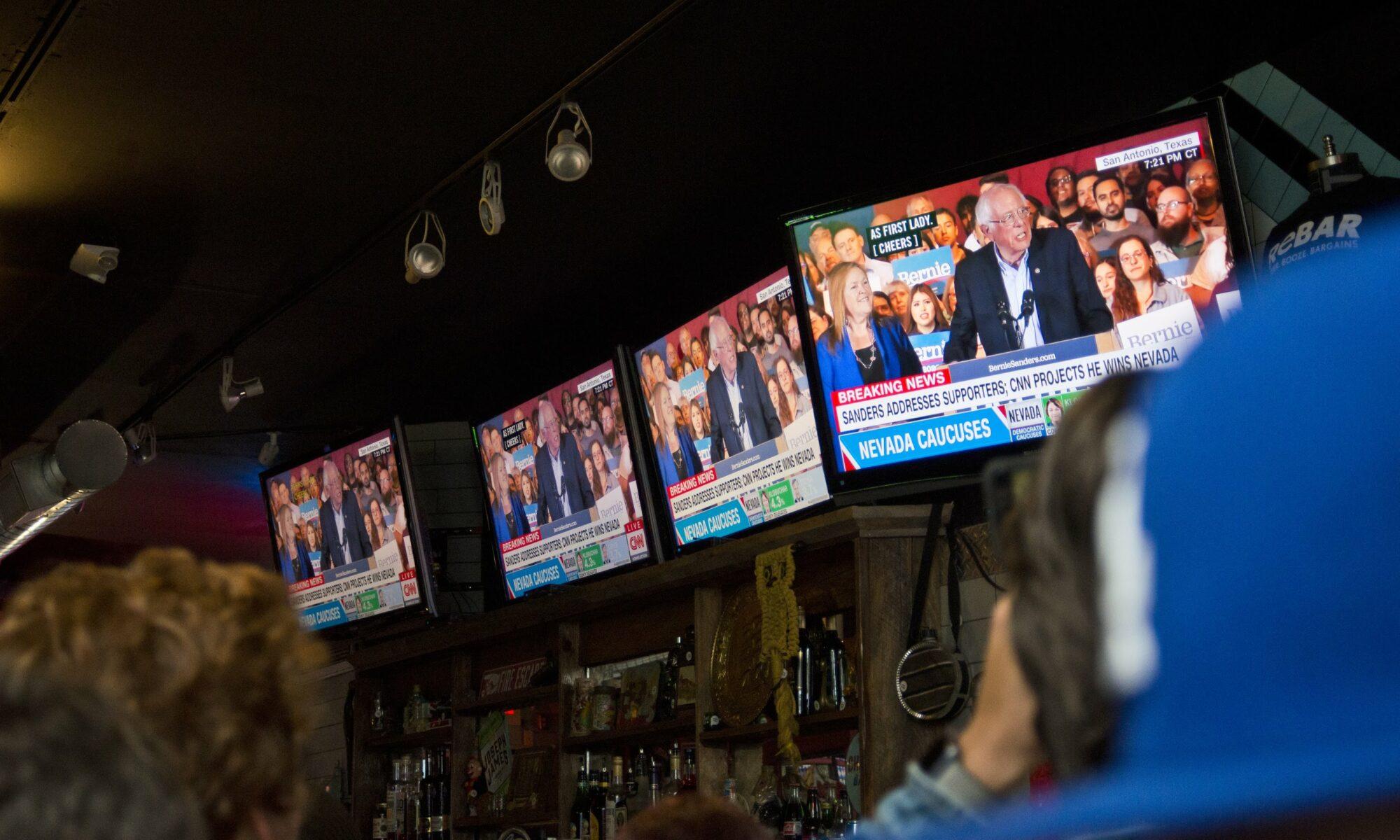 Bernie Sanders on television screens at ReBar in Las Vegas