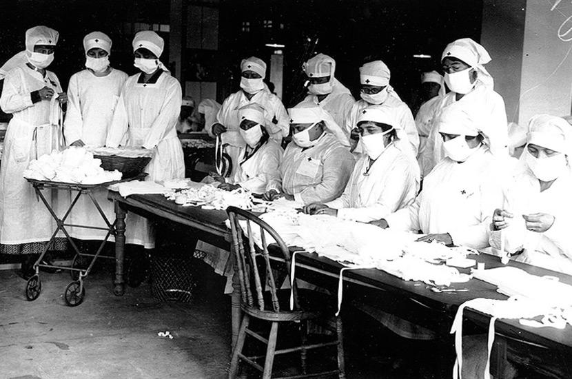 Red Cross volunteers make masks for Spanish flu