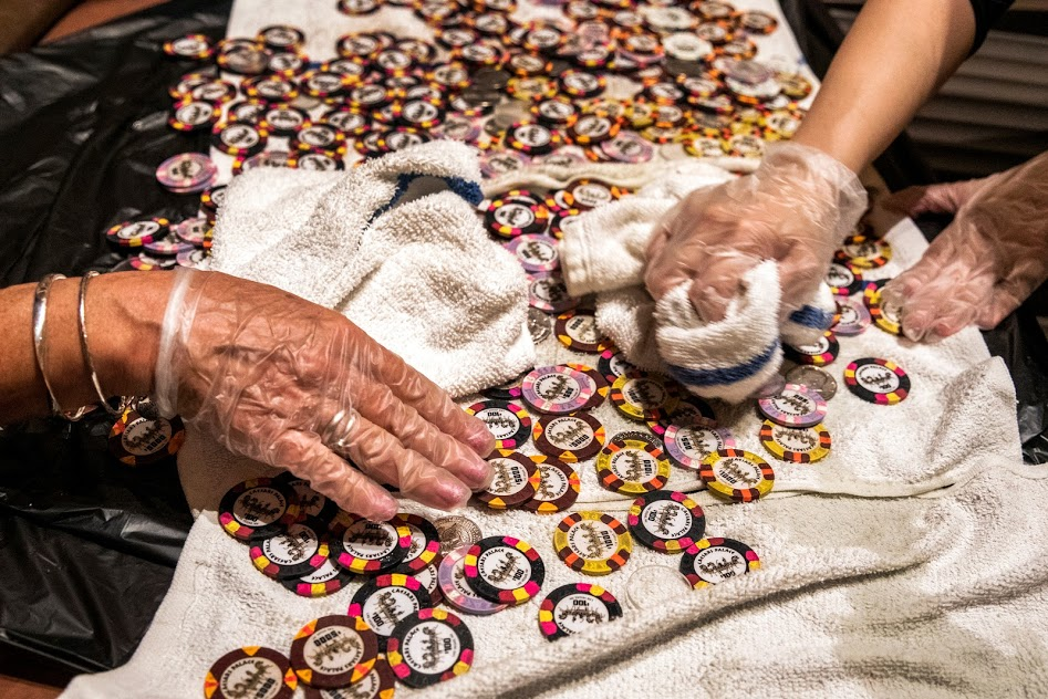Employees at Caesars Palace disinfect casino chips at the property
