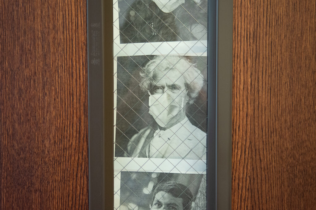 A photo illustration of Mark Twain wearing a mask decorates the Senate GOP office door
