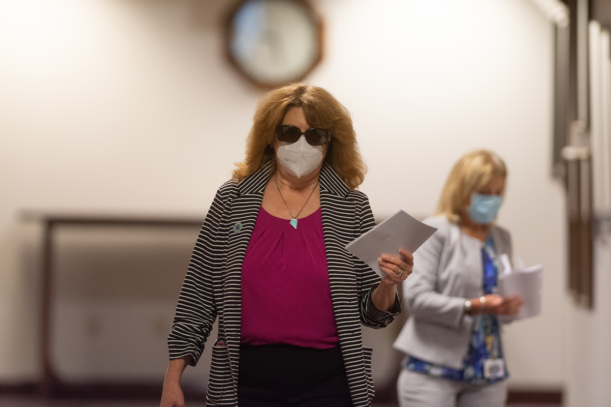 Assemblywoman Ellen Spiegel walking in a hallway with papers in her hand