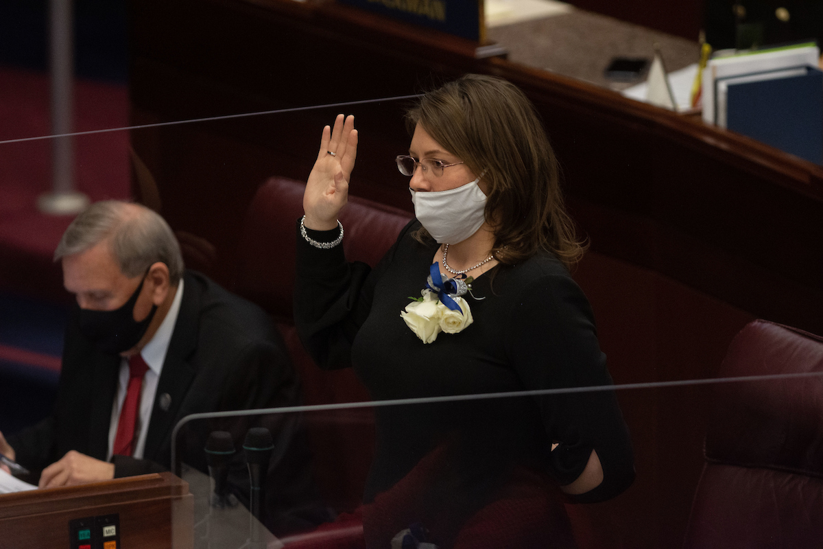 Assemblywoman Annie Black standing with her right hand raised