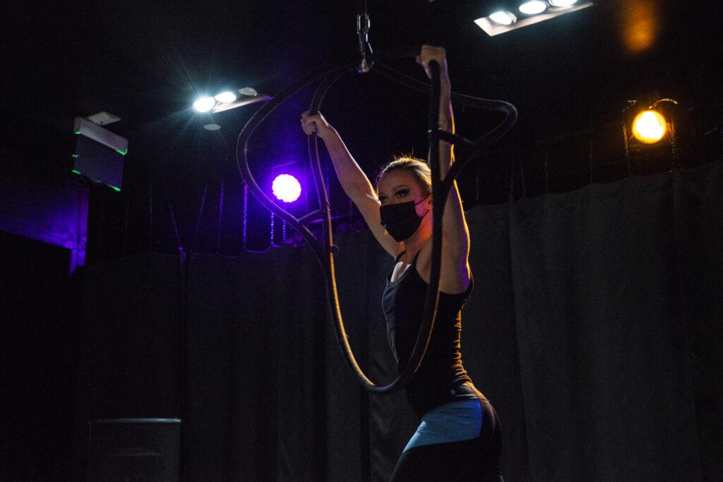 Aerial hoops artist Angelique Janowski hangs from a hoop