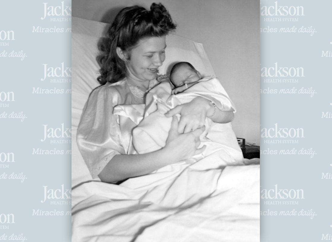 Mother holding her newborn baby at Jackson Memorial's Newborn Intensive Care Unit