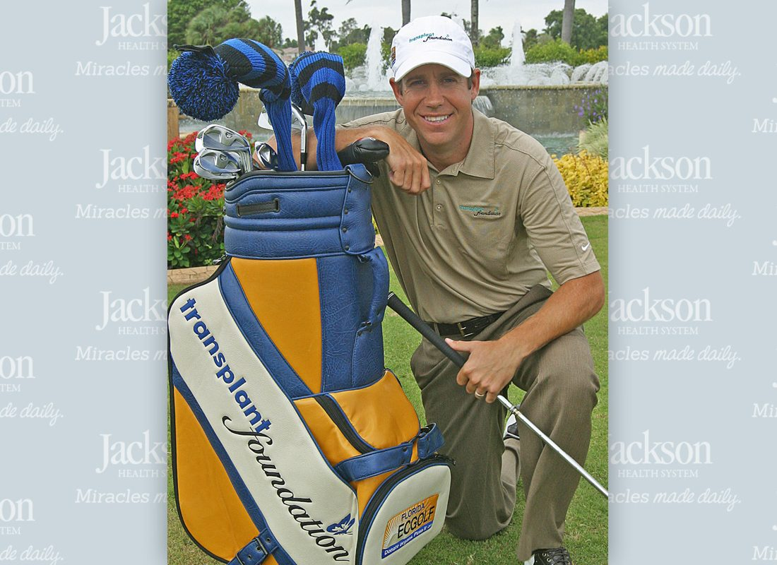 Jackson Memorial Hospital heart transplant patient and professional golfer Erik Compton with golf club and equipment