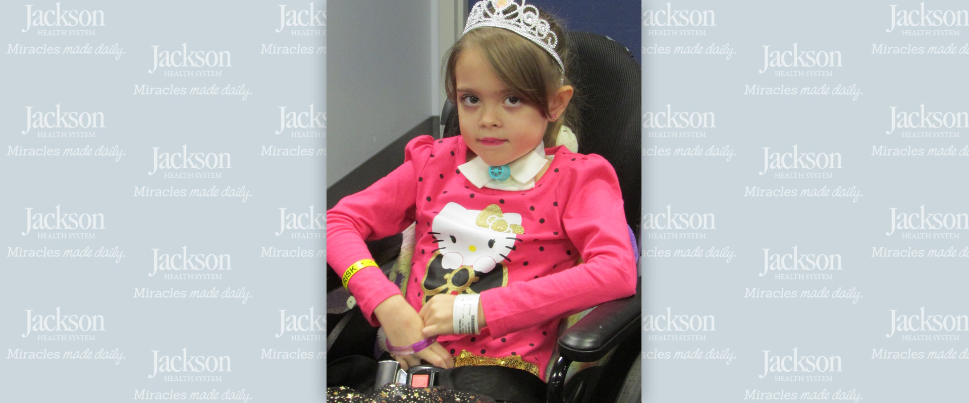 Six-year-old girl sitting on wheelchair after surviving deadly flu virus