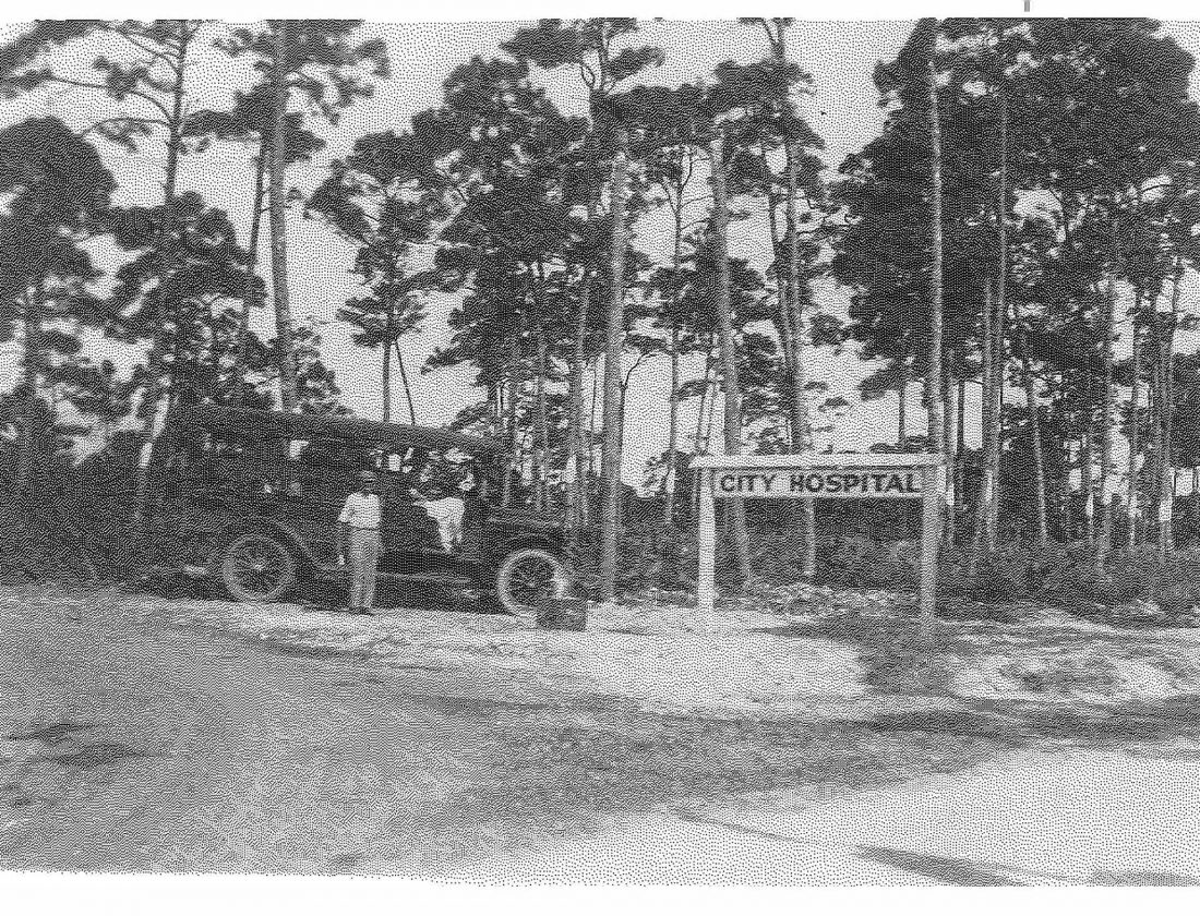 Miami City Hospital sign and vintage car in 1911