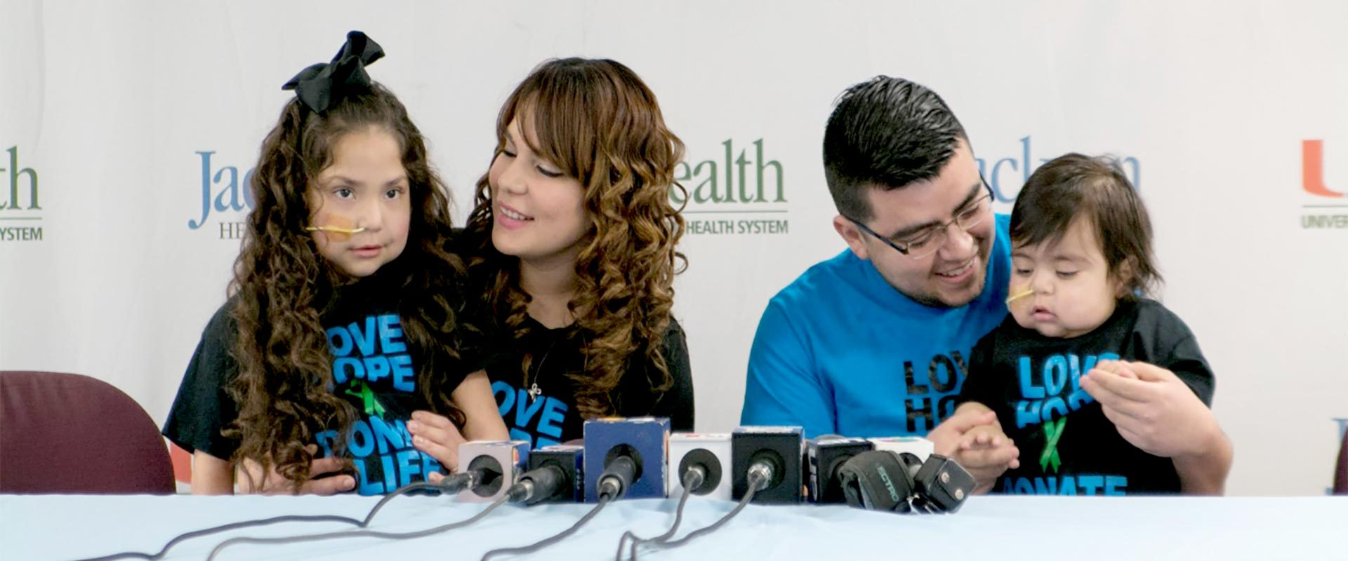 Two young siblings at press conference after receiving fifteen organs at Jackson