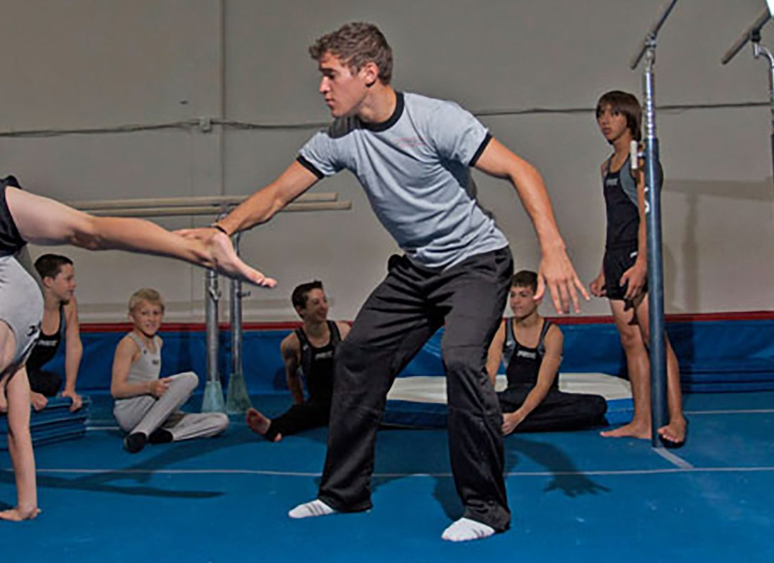 Children in gymnastics with initially paralyzed instructor