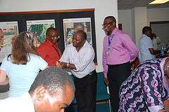 IITA's DG, Dr. Sanginga shaking hands with scientists