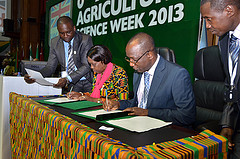 Tiemoko Yo, chairman of FARA and Tumusiime Peace of African Union signing  MOU