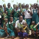 Children with tree seedlings. Photo: Joseph Otim