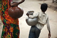 Bringing back water using pitchers in Khulna, Bangladesh. Photo by Felix Clay/Duckrabbit, 2013.