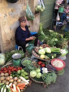 Vendor in wet market in Hanoi