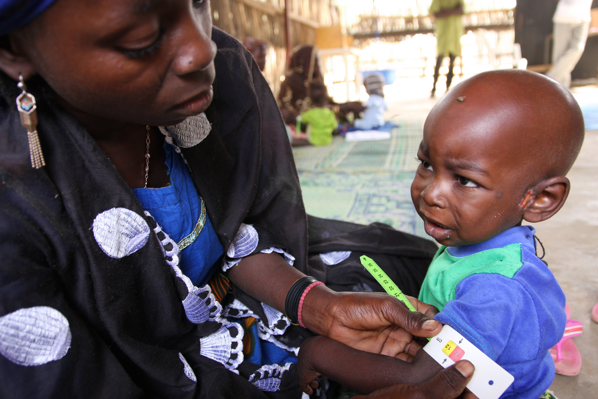A woman in Niger measures her baby's arm circumference—part of a program that teaches mothers to regularly monitor for signs of malnutrition. Such integrated nutrition interventions can play a key role in improving overall public health, according to IFPRI Senior Research Fellow Harold Alderman.