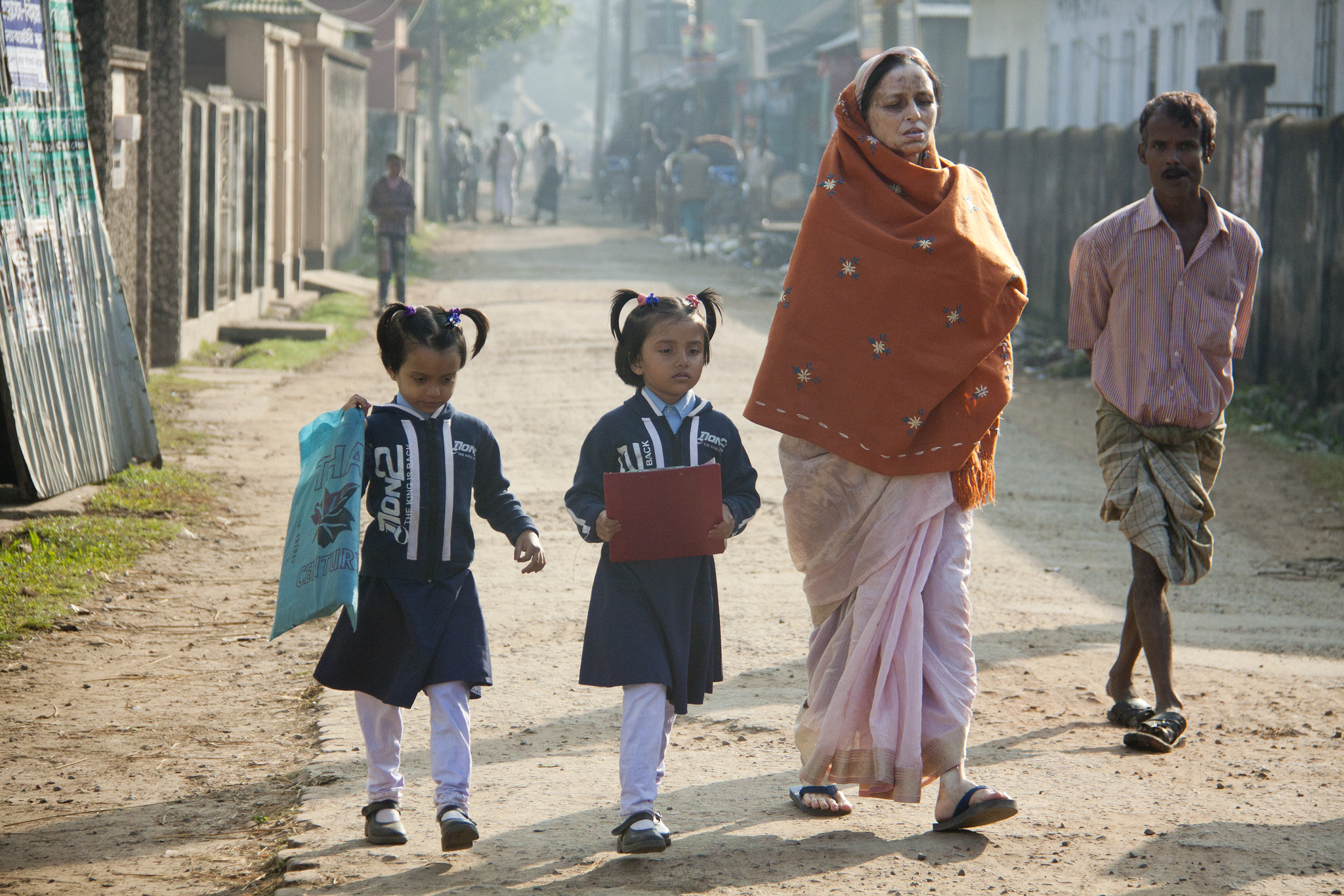 Children going to school with their mother