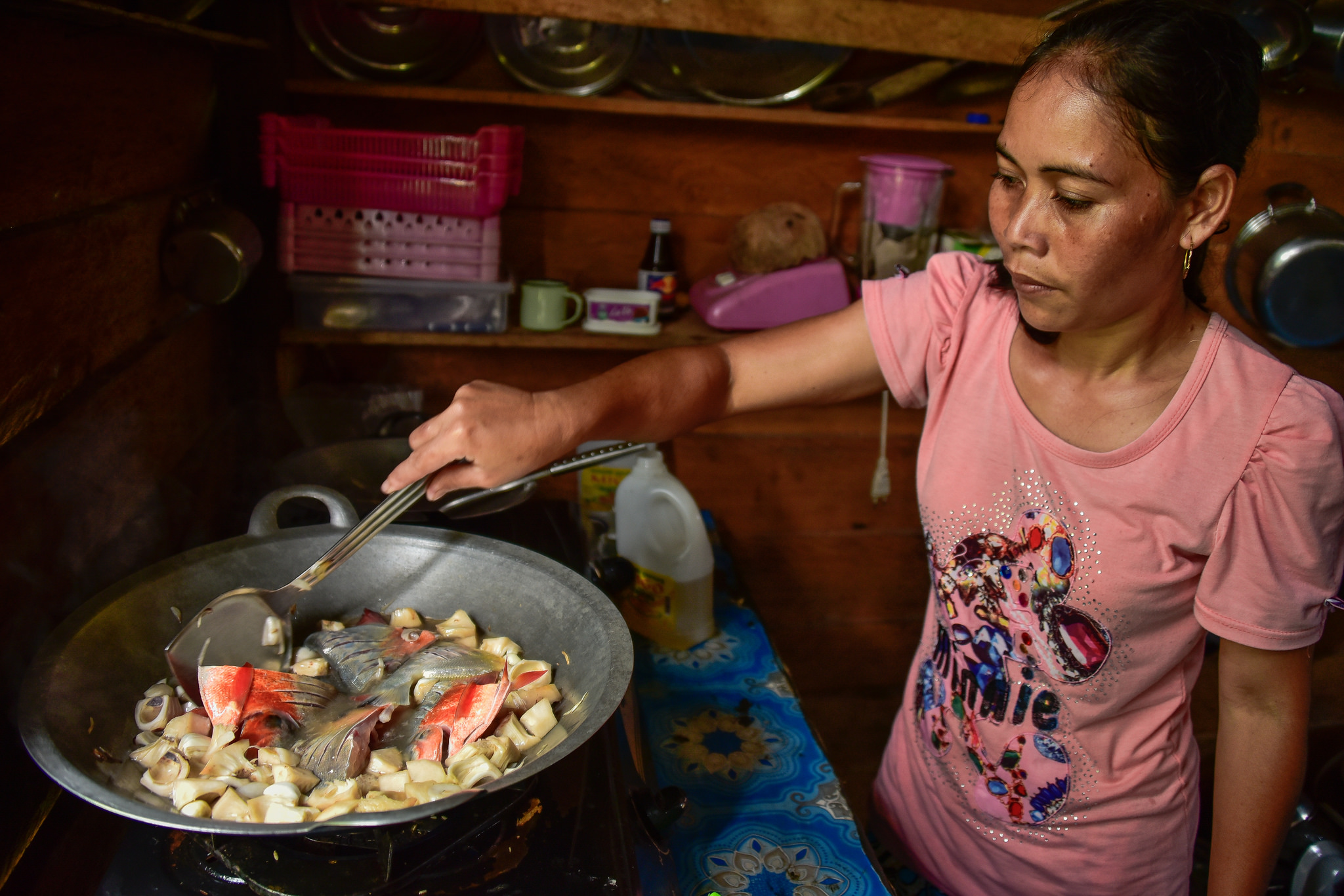 Indonesian woman cooks food : Changing diets in Kapuas palm oil