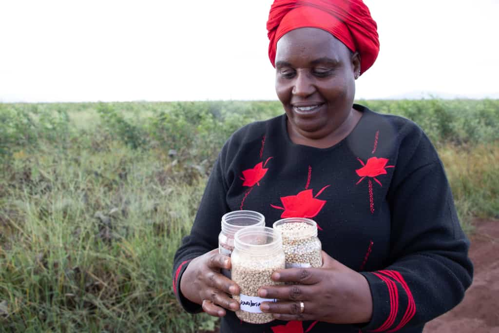 Farmer Betty shows her certified seed for her farm in Emali, Makueni County. Photo: AVCD