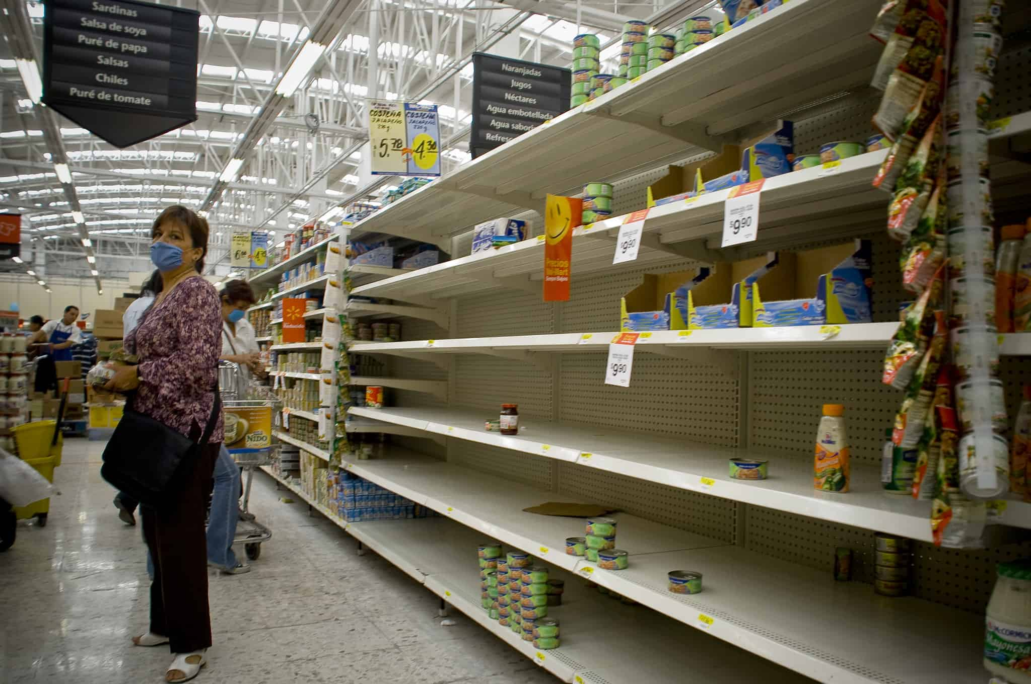 Shoppers stock up on food supplies in reaction to news of spreading disease