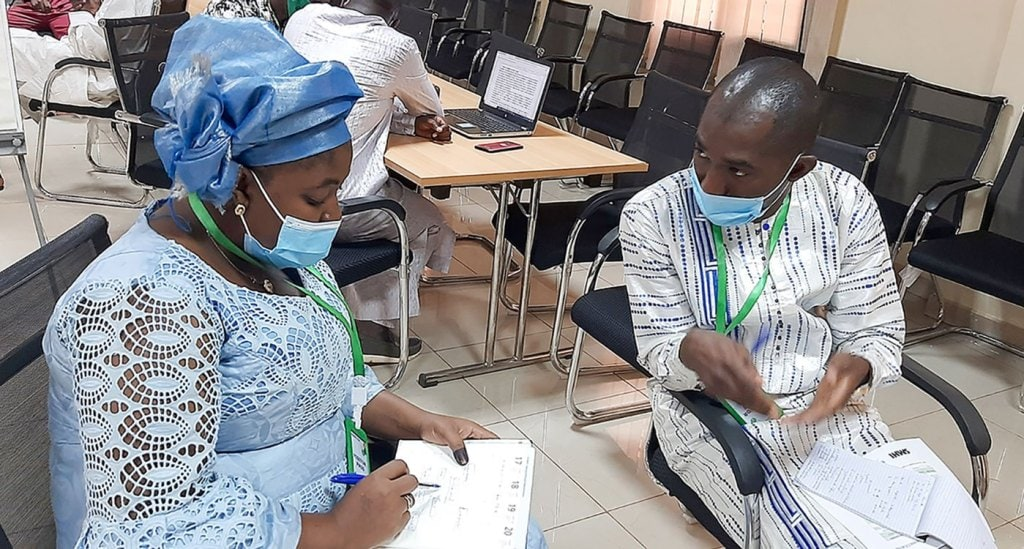Ms Sow Coumba Kone and Mr Mamadou Diakité, participants from Mali-Météo preparing their project brief. Photo. A. Diama, ICRISAT
