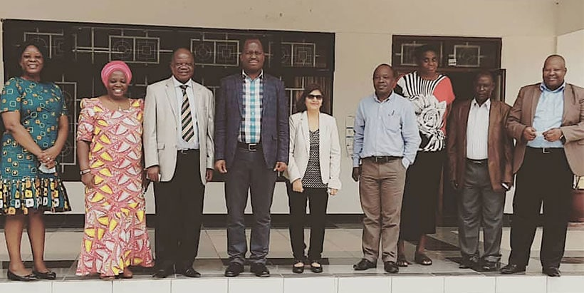 Permanent Secretary, Mr Gerald Kusaya (center), flanked by Emeritus Director Victor Manyong (left) and Director for Eastern Africa, Dr Leena Tripathi (right), with other IITA staff.