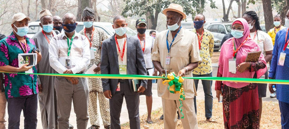 evelopment and Delivery Office Director, Alfred Dixon, cuts the ribbon to kick off the exhibition.