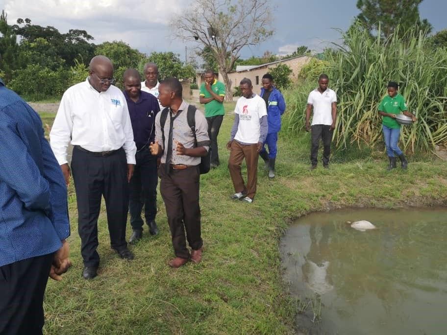 Intern Francis Banda speaks to the Zambia Bureau of Standards about farm certification.
