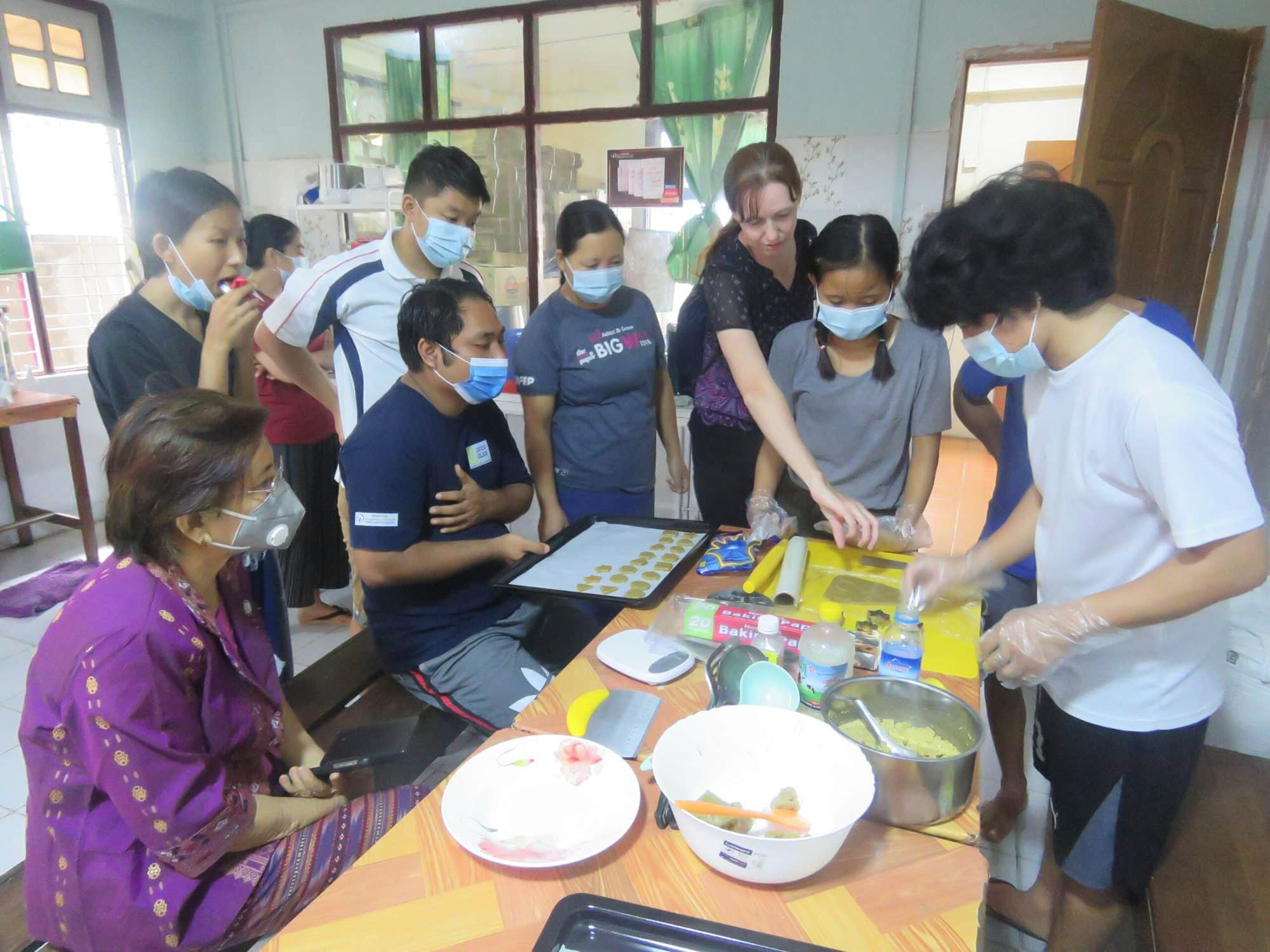 Youth prepare nutritious biscuits using FedWell's dried small fish powder. Photo by Thomas Tha Thaw.