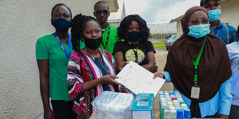 GoSeed's Mercy Diebiru-Ojo (left) receiving 42 plant form temporary immersion bioreactors (TIS) and 40 plantlets from YIIFSWA's Morufat Balogun.