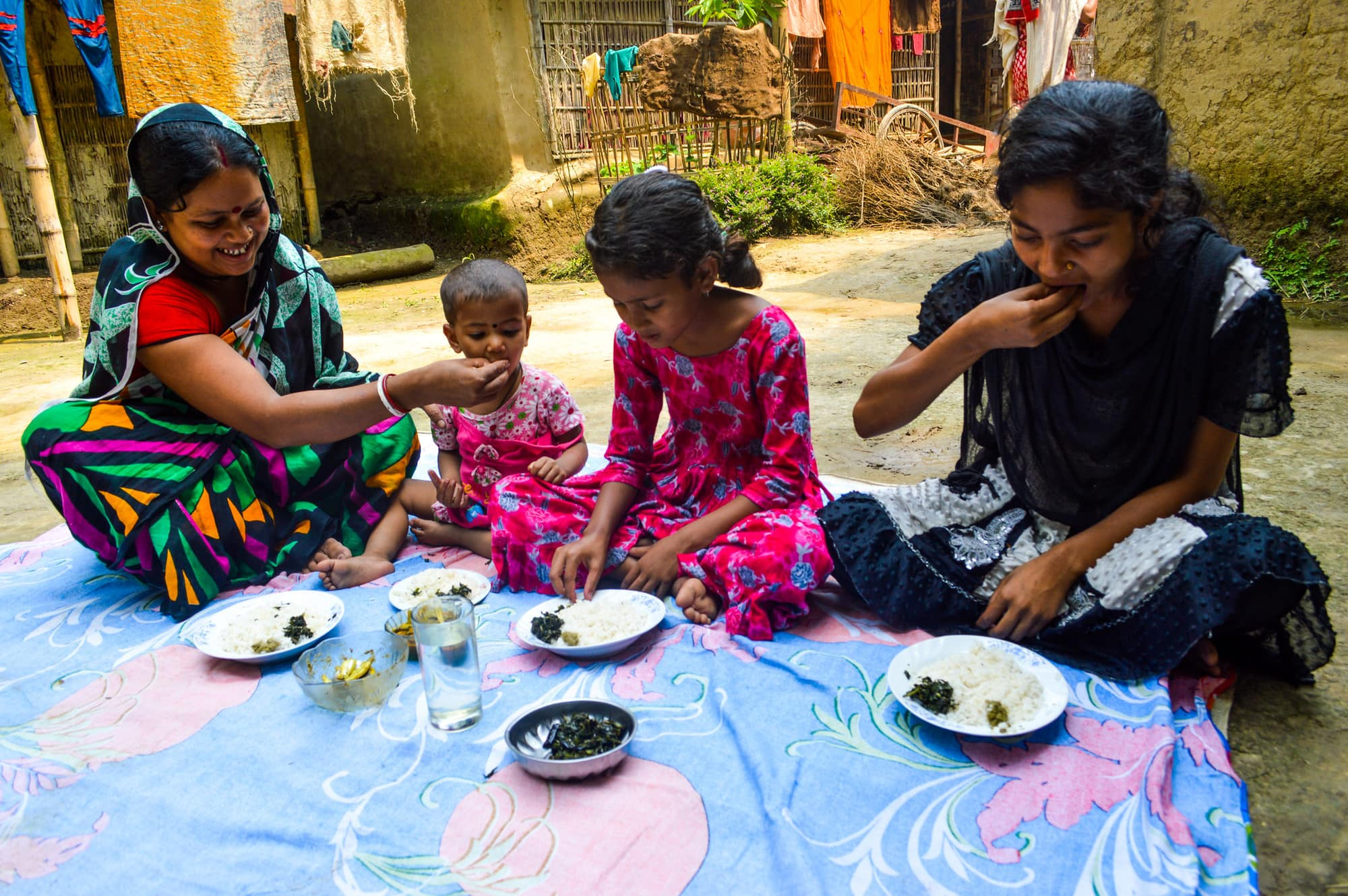 Pronoti Rani and her children eat nutrient-rich small fish in their meal in Moulavibazar, Bangladesh. Photo by Mohammad Mahabubur Rahman.