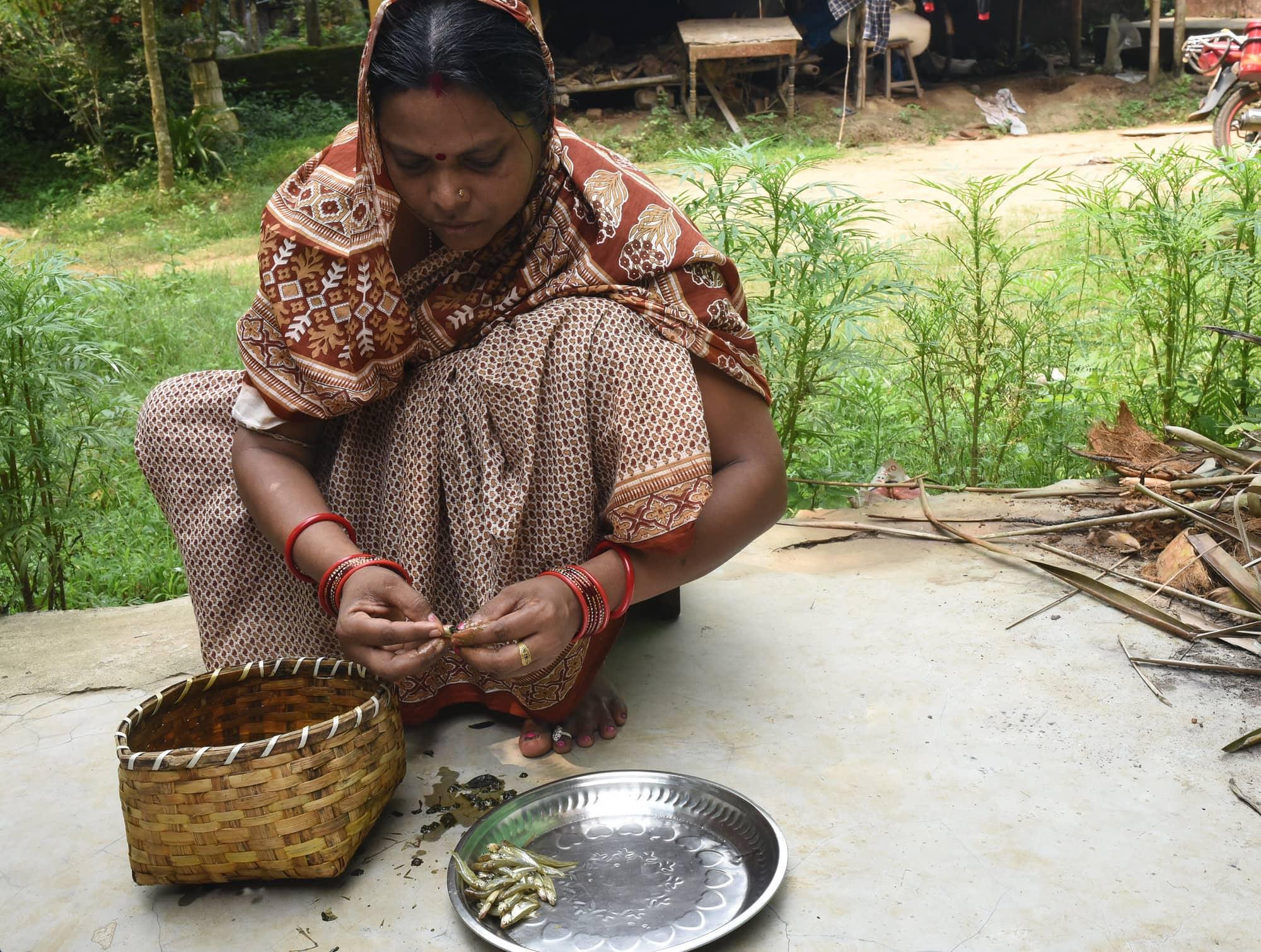 Urebashi Mallick prepares fresh mola in Gobindpur village Odisha India