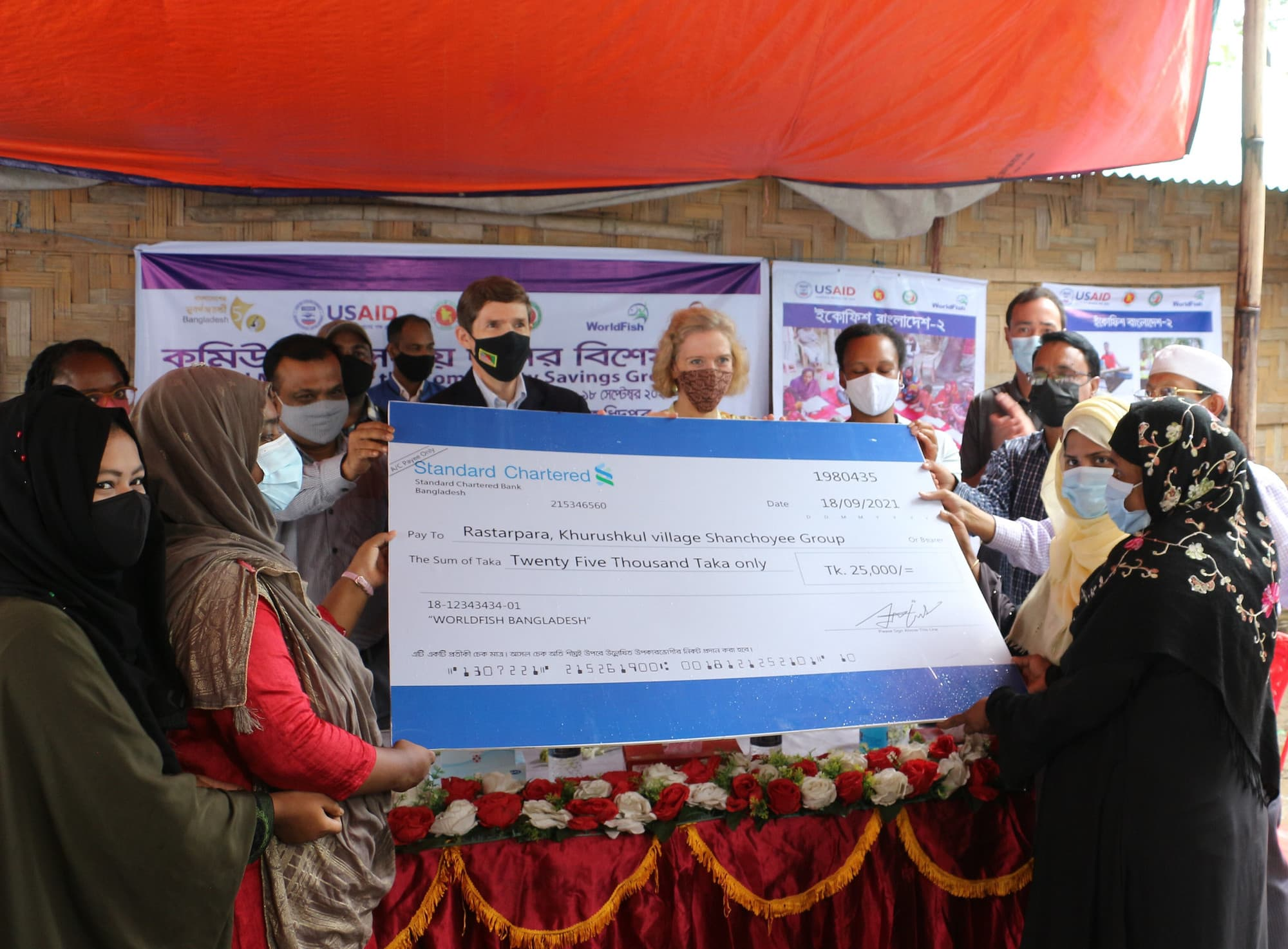 Community savings groups (CSG) receive matching grants. Photo by Md. Asaduzzaman