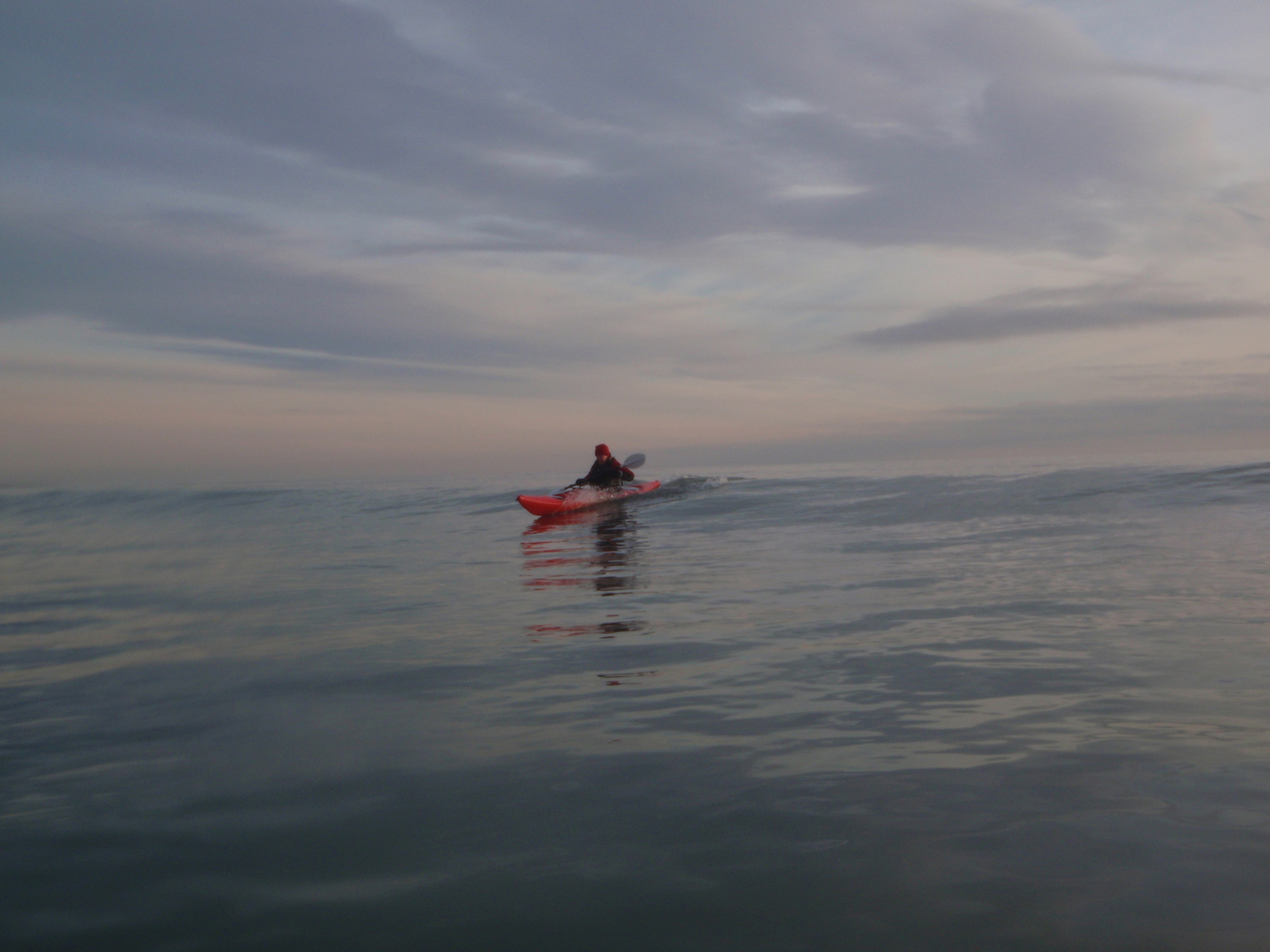 Surfing a sea kayak on a 3 star sea kayak course