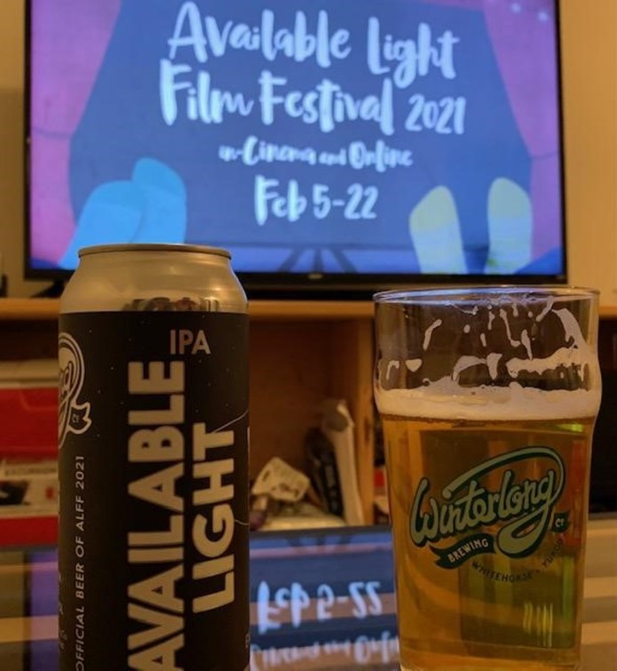 Enjoying the official beer of the festival while we watch our first of many of the films