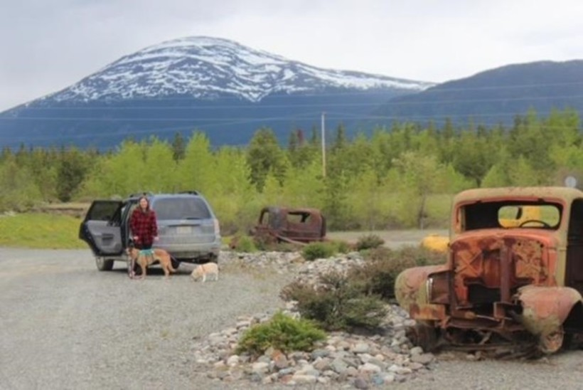 The beginning of the South Canol Road where you can see some of the old trucks used during the construction
