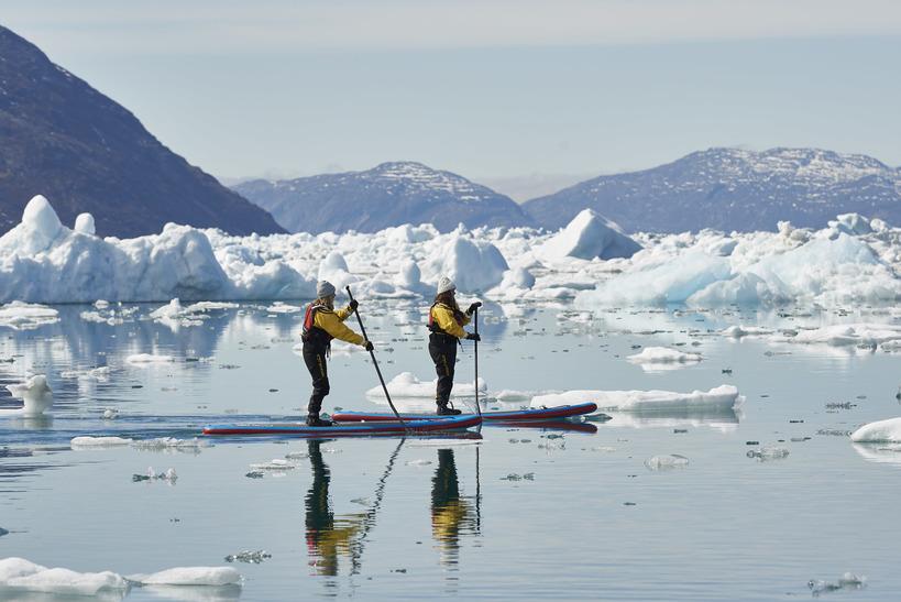 Stand Up Paddling among Icebergs