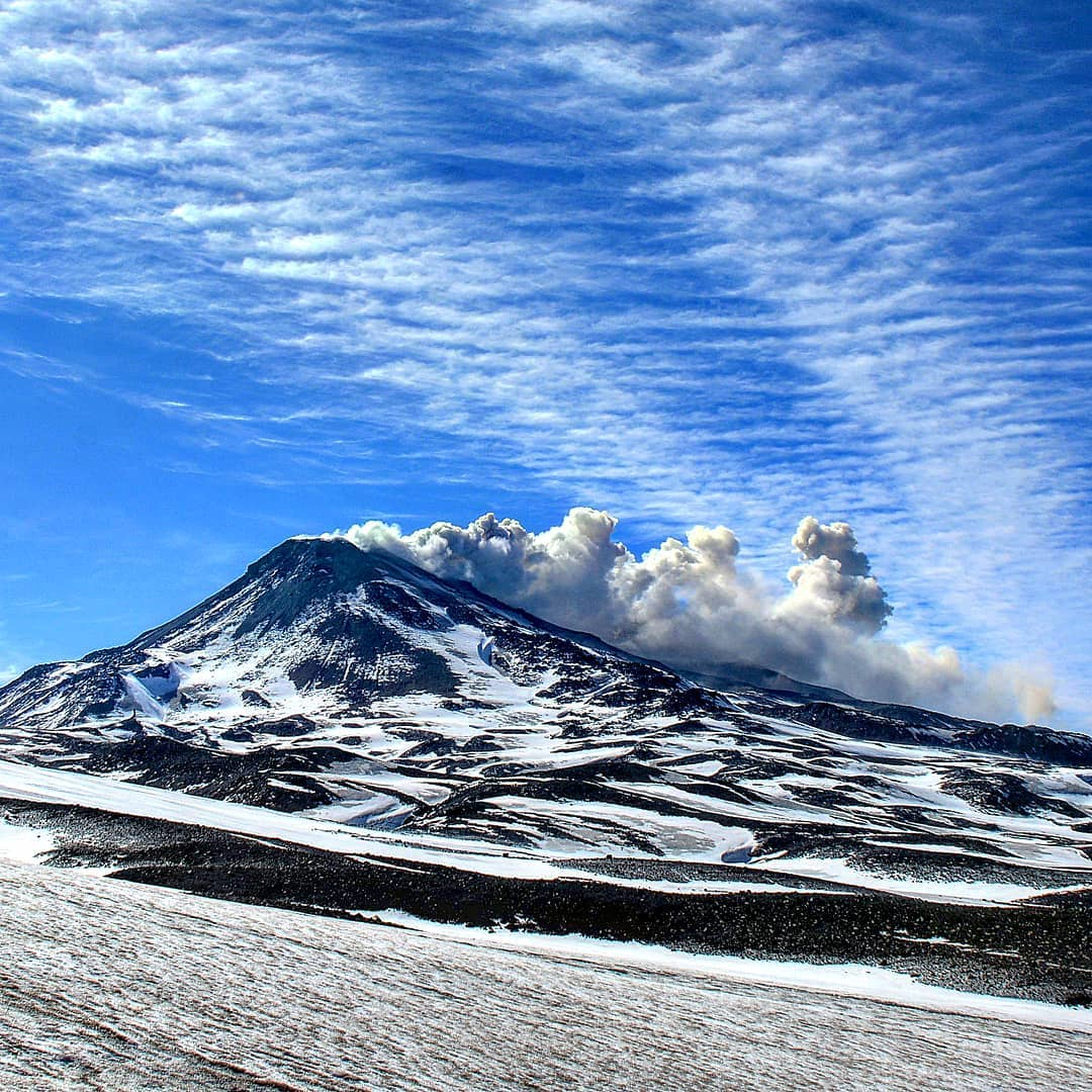 Snow-capped Chillán volcano with fumarole