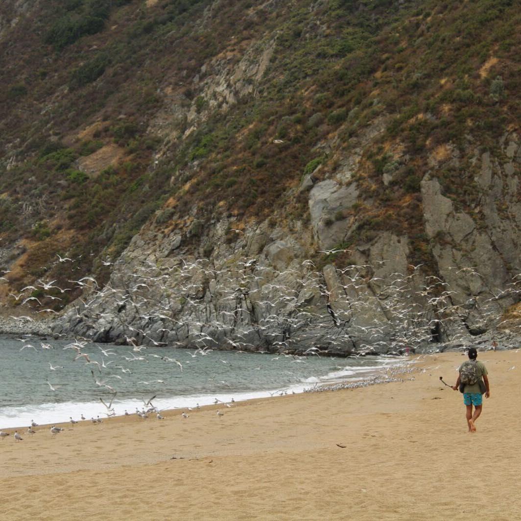 Visitor walking along Laguna Verde beach