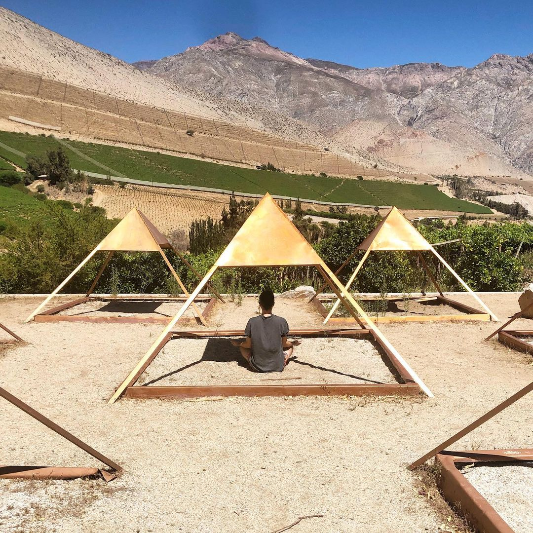 Man meditating by the pyramids of Cochiguaz, Elqui Valley