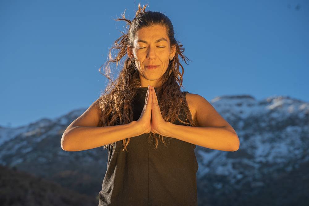 Woman in a meditative state at the foot of the Andes Mountains
