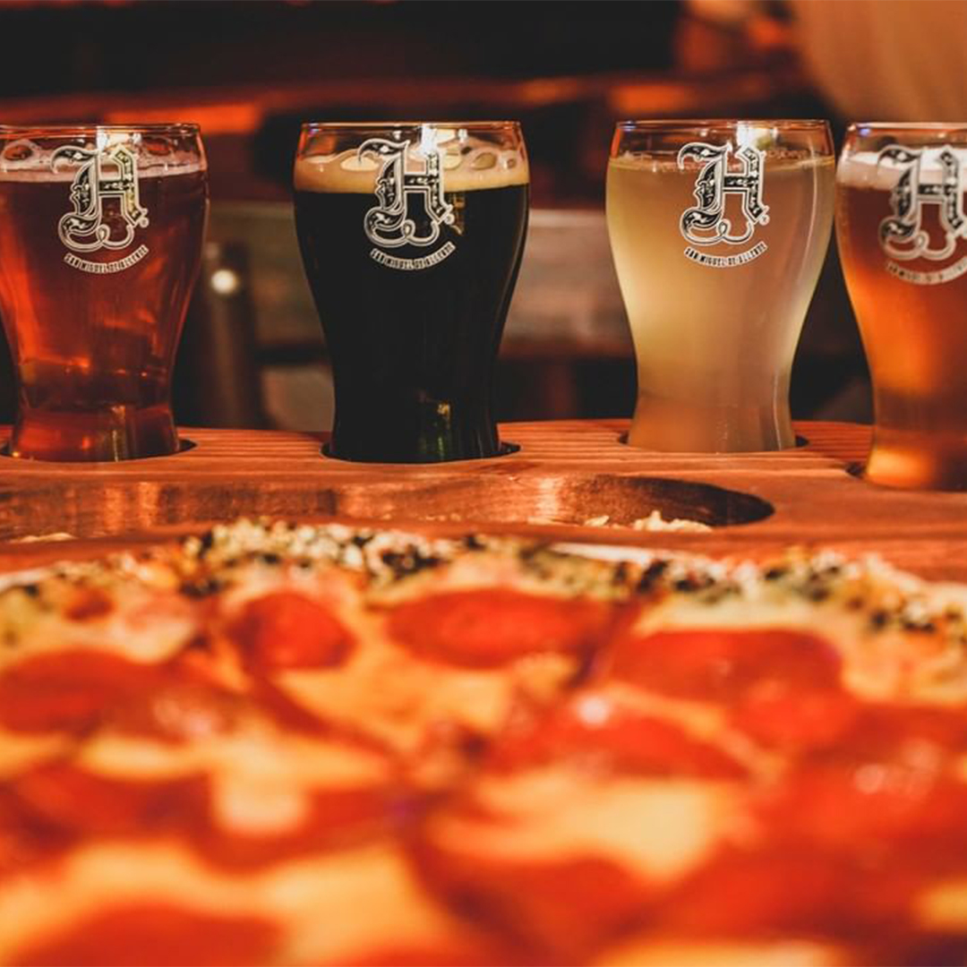 Six glasses with different types of craft beer