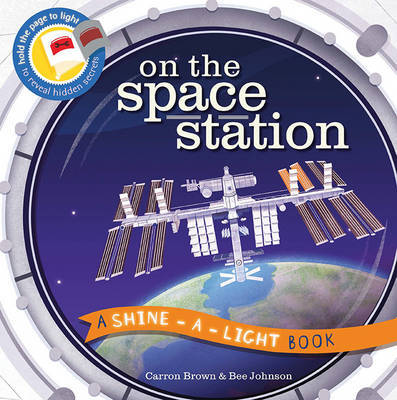 On the Space Station (A Shine-a-Light Book)