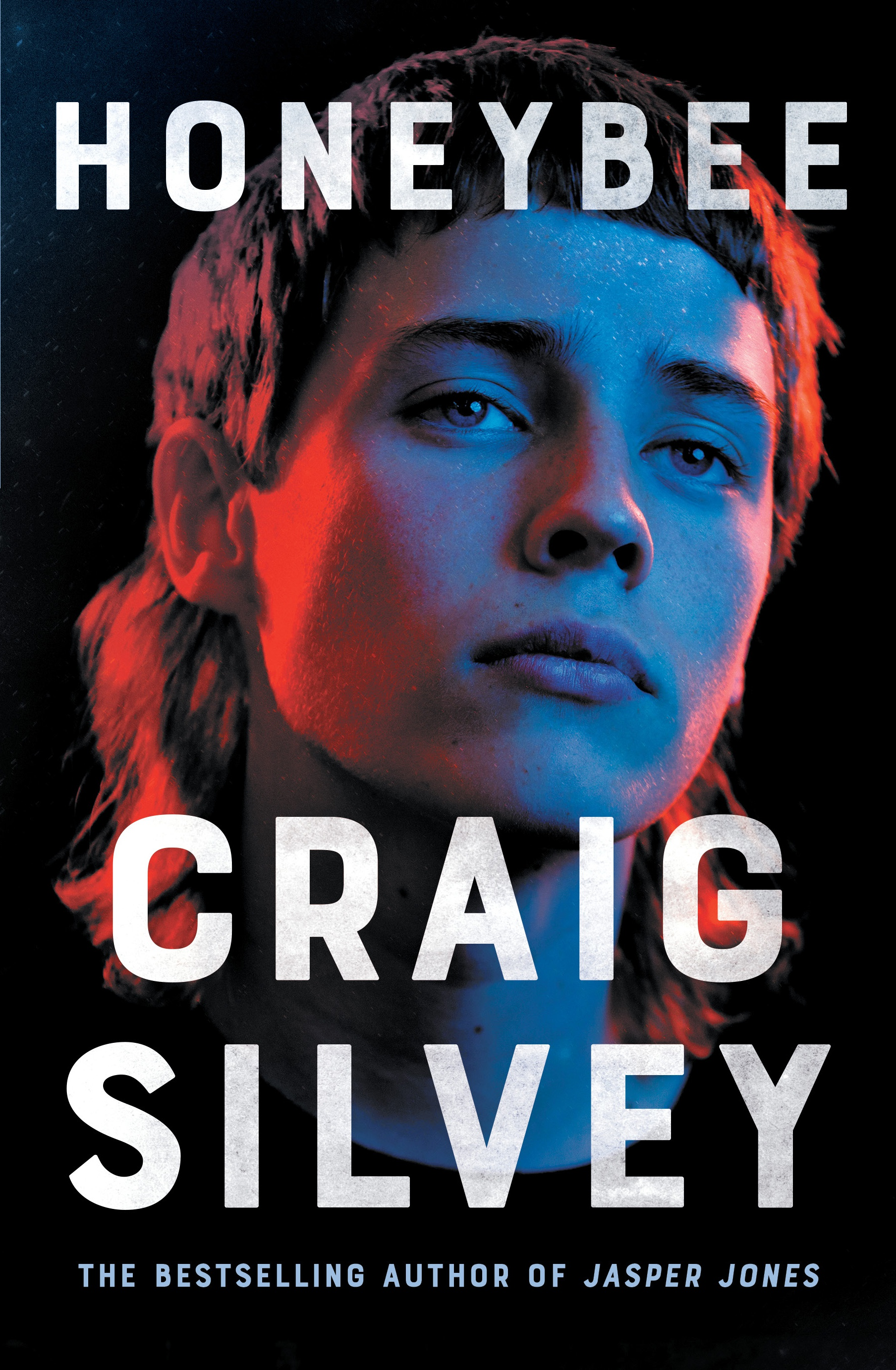 Cover of Honeybee by Craig Silvey, showing a young person's face lit up in blue and red