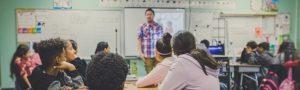 Classroom teacher talking to attentive students