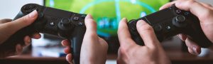 hands holding game controllers
