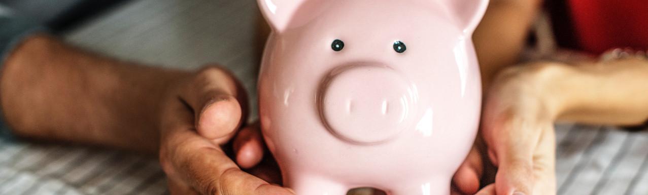 pink piggy bank being held