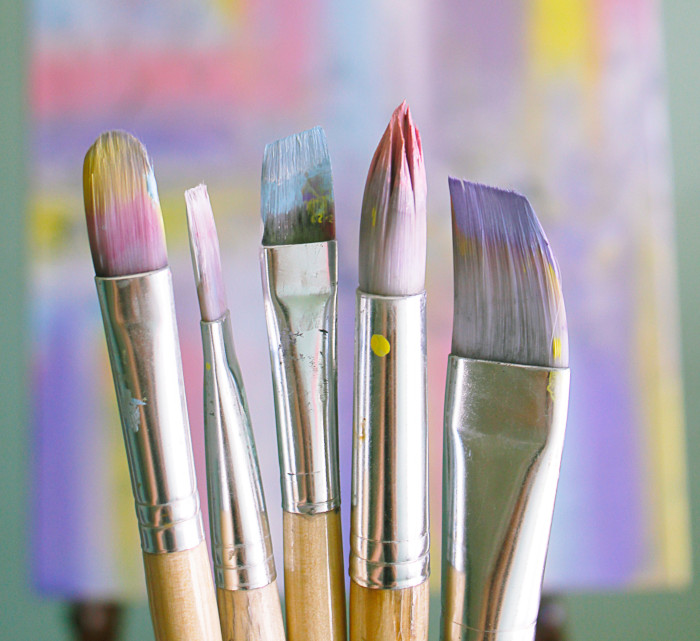 paintbrushes with pastel painting on them