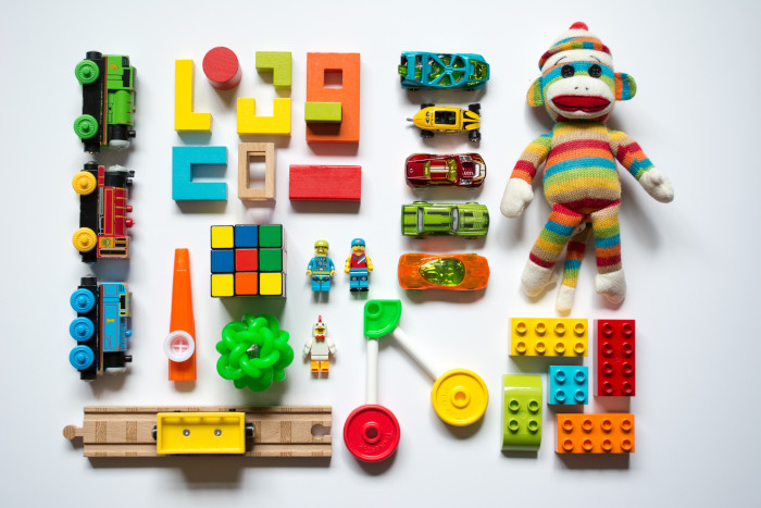 Toys laid on a white floor