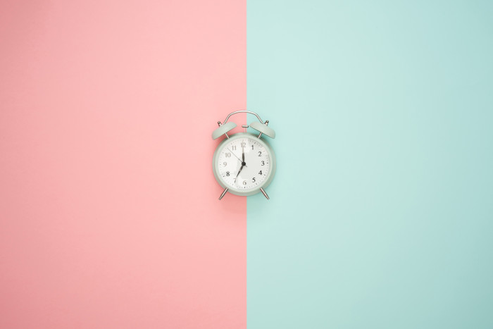 Alarm clock with blue and pink background