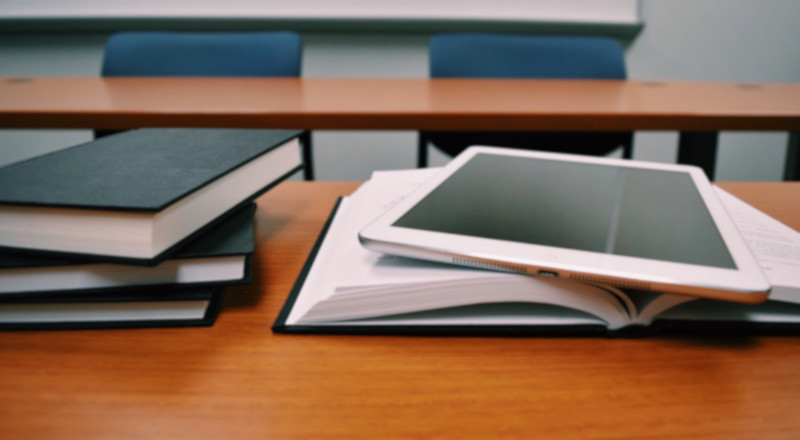Silver tablet on school books